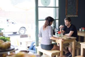 A man and woman sitting inside Table Thirteen restaurant