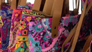 Row of colourful handbags handmade by Bev in Sandton.