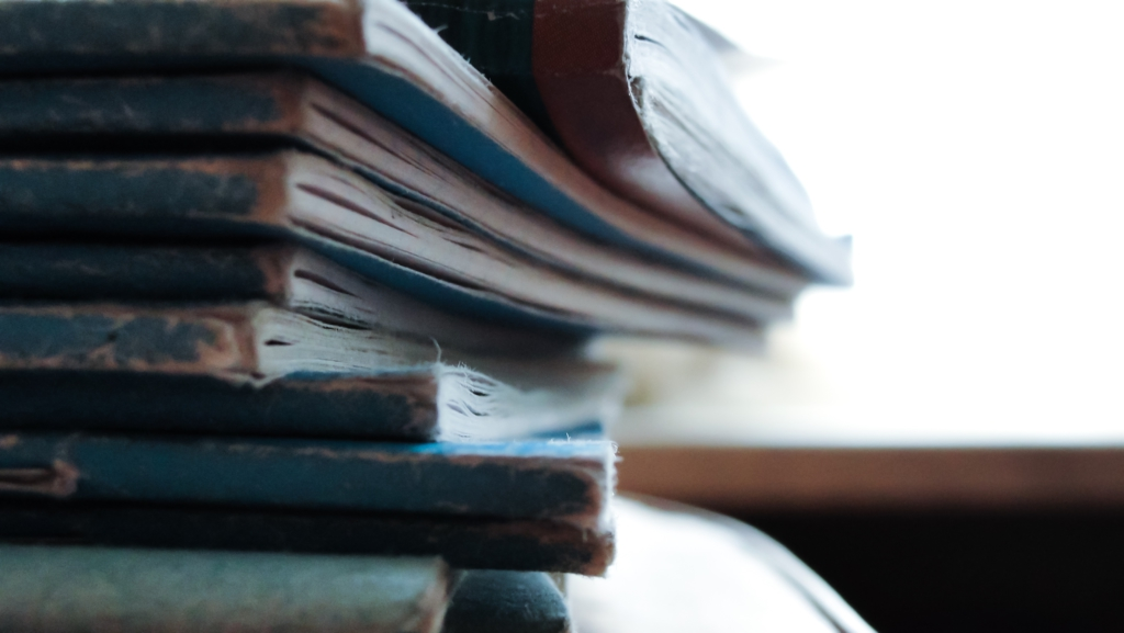 A stack of well-worn note books.