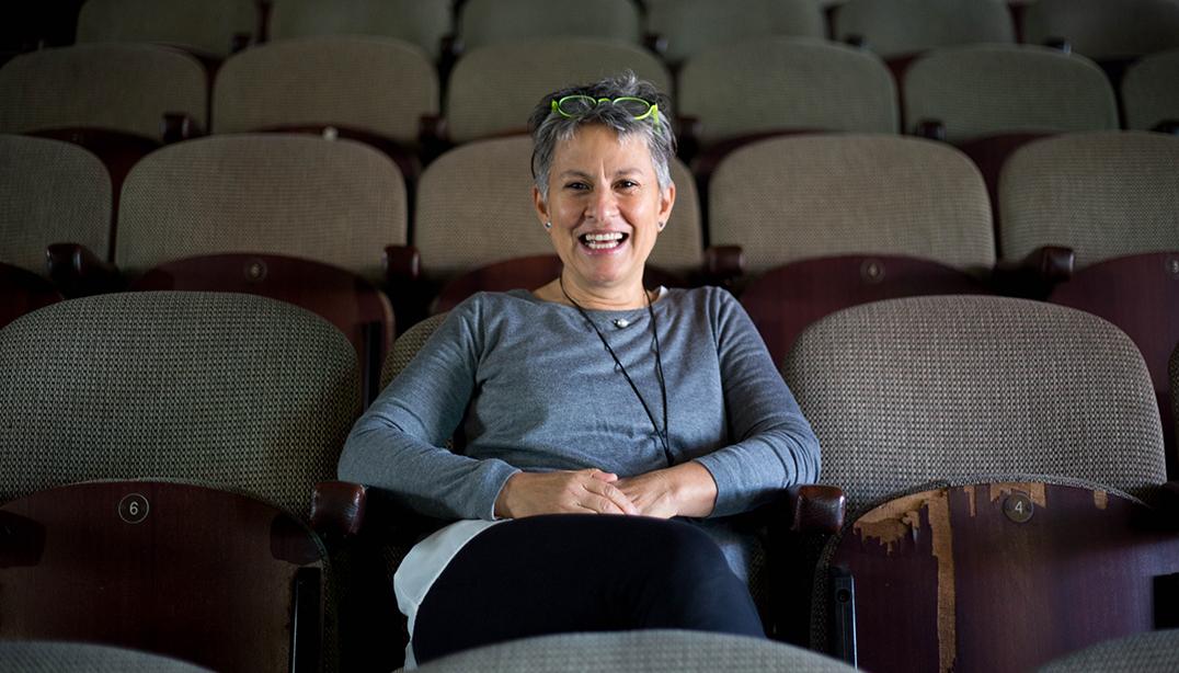 Jennie Reznek sitting in the Magnet Theatre