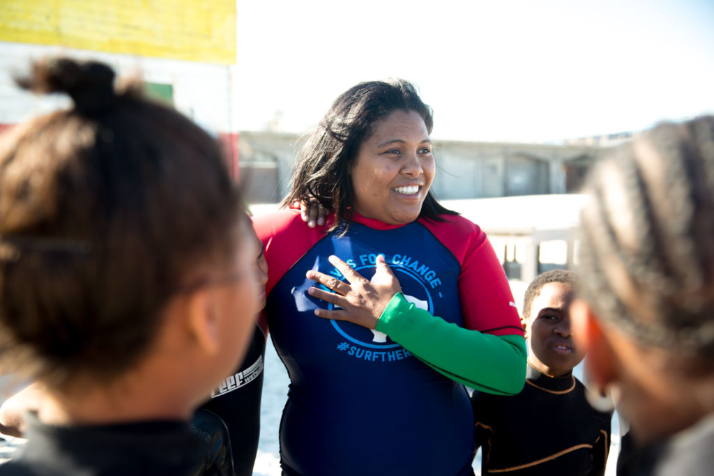 Melreen Devilliers from Waves For Change smiling with her hand on her chest