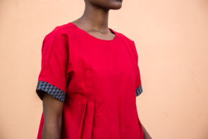 Woman wearing a red Imveli Designs garment