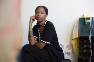 Lungiswa Gqunta wearing a black dress